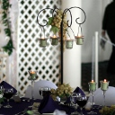 Our wrought iron tabletop candelabra with a simple arrangement of grapes.