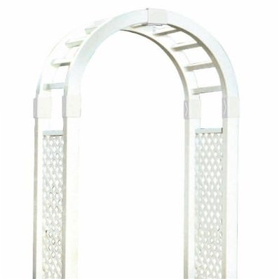 A white archway with lattice work along the vertical sides and a simple cross-frame across the arch.